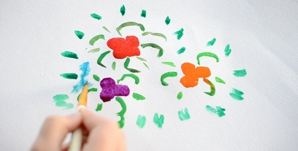 The Child Draws A Flower