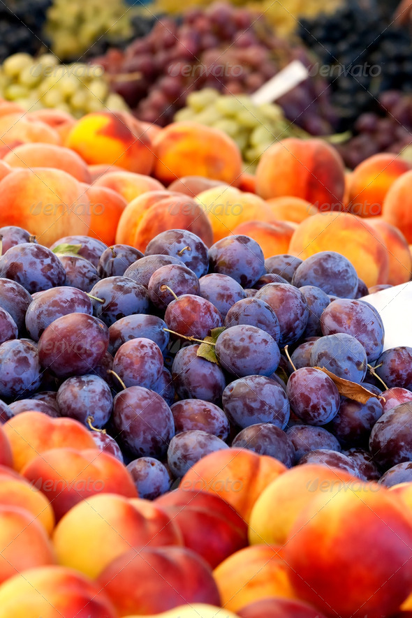 Heap Of Fresh Organic Peaches And Damson Plums  - Stock Photo - Images