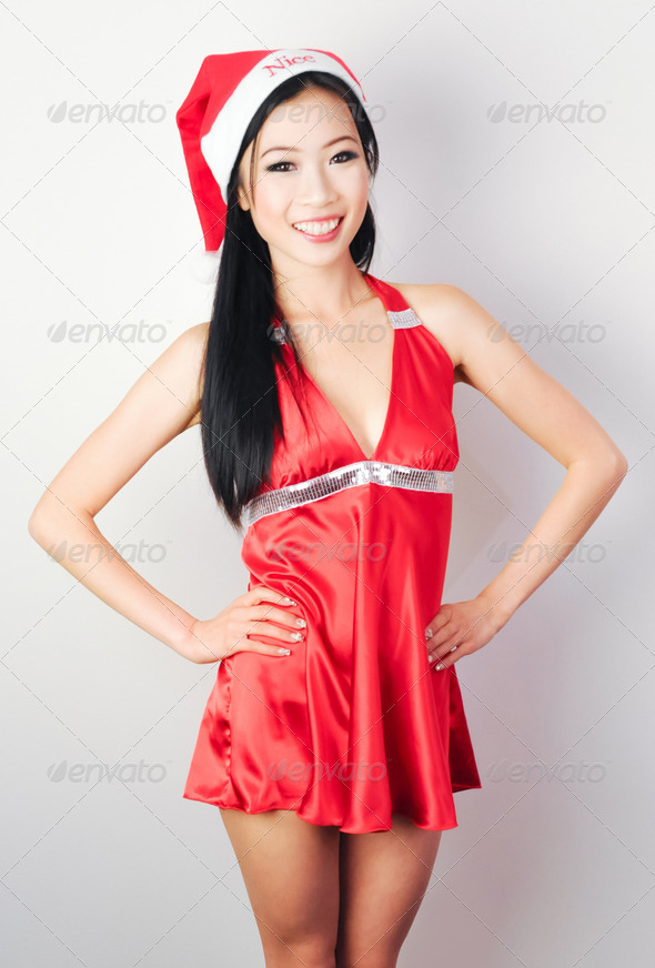 Miss Asia in Christmas Red Dress - Stock Photo - Images