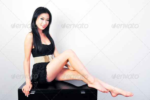 Beautiful Asian in Black Robe - Stock Photo - Images