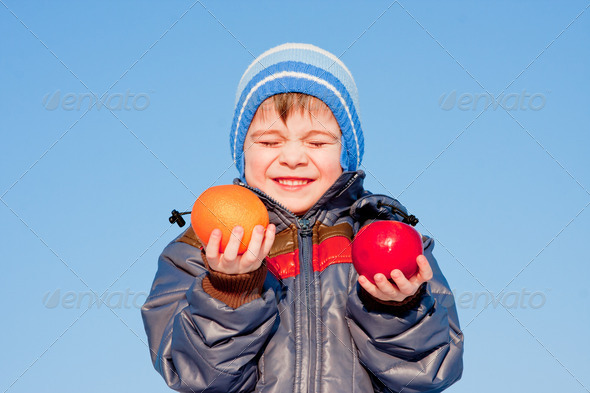 PhotoDune boy with fruit in hands on nature 3665068