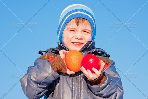 PhotoDune boy with fruit in hands on nature 3665069