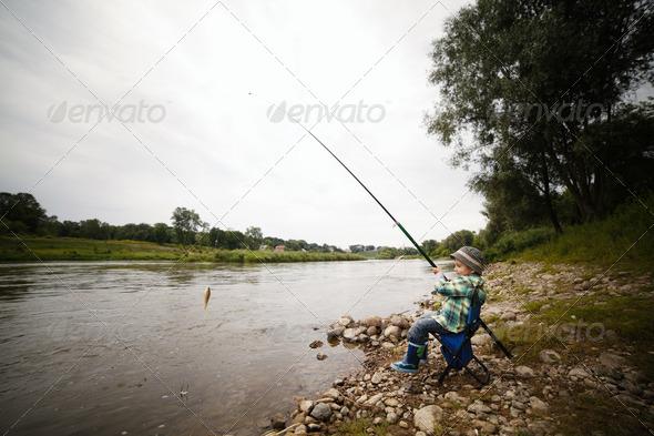 PhotoDune photo of little boy fishing 3669170