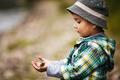 little boy holds a little fish