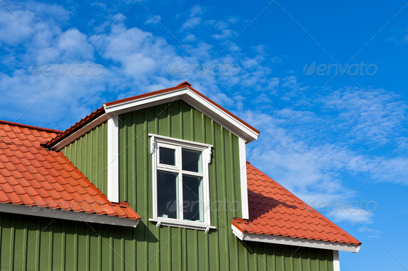 Residential Roof Top under the Bright Blue Sky - Stock Photo - Images