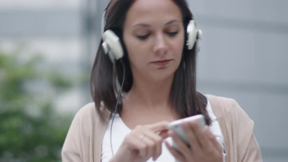 Download Woman Walking on Streets and Listening Music nulled download