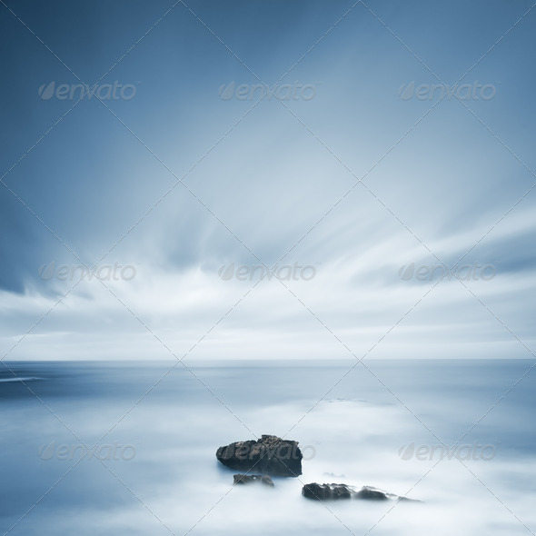 PhotoDune Dark rocks in a blue ocean under cloudy sky in a bad weather 3675650