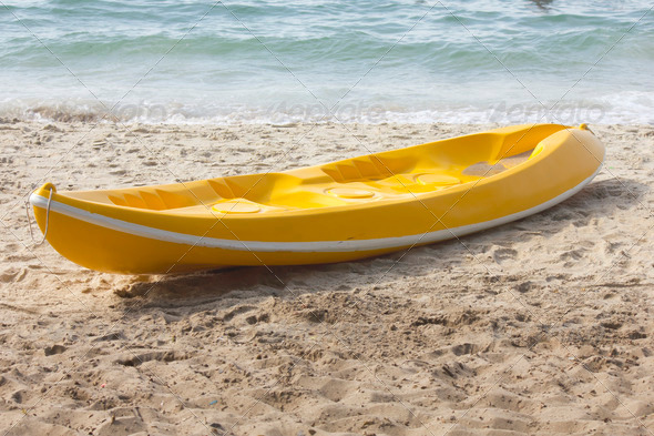 PhotoDune Colourful kayak on the beach 3675852