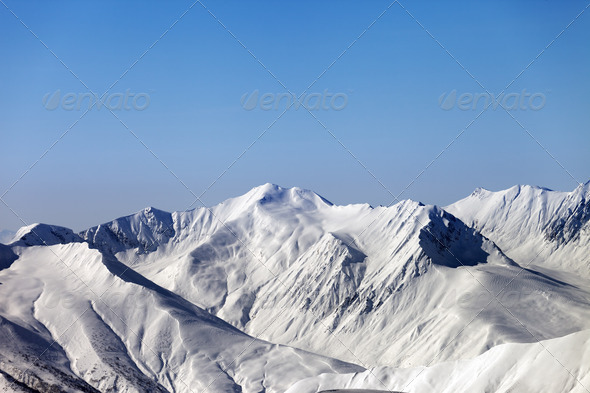 Snowy mountains and blue clear sky - Stock Photo - Images