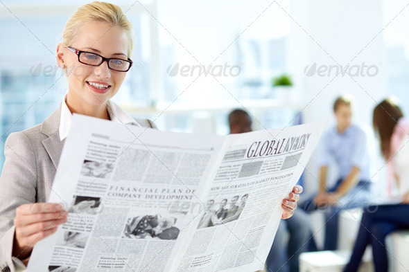 Woman with newspaper - Stock Photo - Images