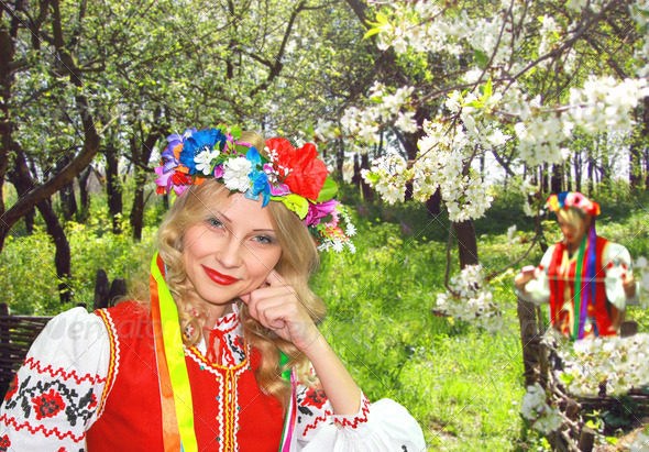 PhotoDune Ukrainian girl in national dress in a flowering spring garden 3678948