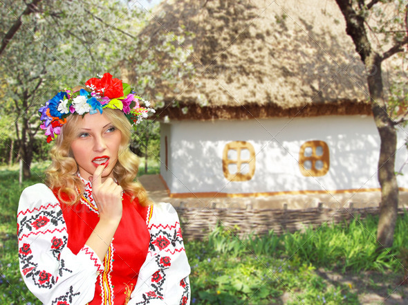 PhotoDune Beautiful girl in the Ukrainian national costume in garden near 3693327