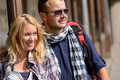 Couple traveling by backpack smiling together trip