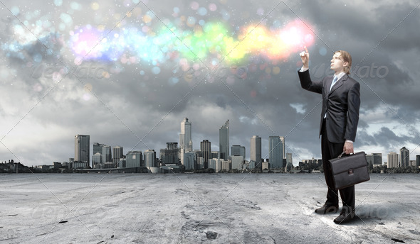 PhotoDune Businessman with colourful light beam in his hands 3706043