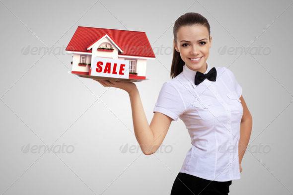 PhotoDune Waitress holding a tray with a house on it 3706055