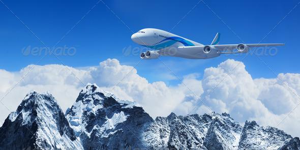 PhotoDune White passenger plane above the mountains 3706076