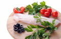cod steak with tomatoes olives and parsley isolated on a wooden board - PhotoDune Item for Sale