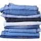 stack of different kind of blue jeans, on white background - PhotoDune Item for Sale