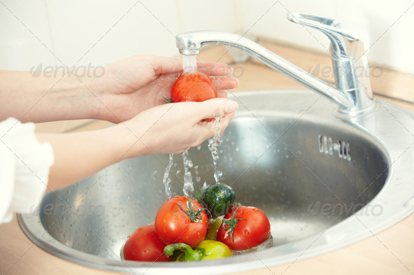 Washing vegetables - Stock Photo - Images