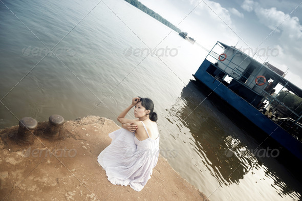 Lady at the wharf - Stock Photo - Images
