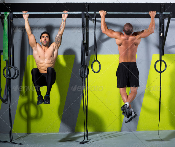 Crossfit toes to bar men pull-ups 2 bars workout - Stock Photo - Images