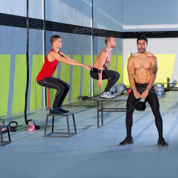 Crossfit box jump people group and kettlebell man - Stock Photo - Images