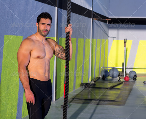 Crossfit man with climbing rope relaxed at gym - Stock Photo - Images