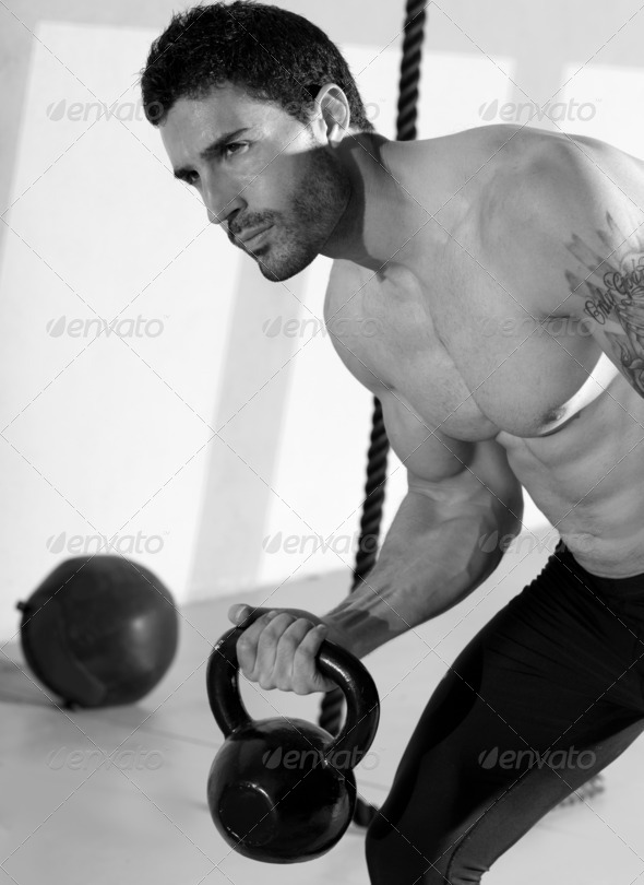 Crossfit man lifting kettlebell workout exercise - Stock Photo - Images