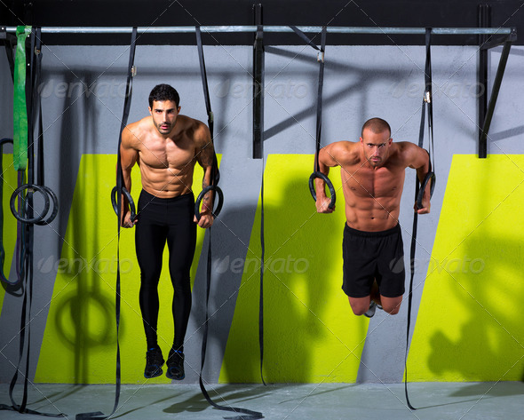 Crossfit dip ring two men workout at gym - Stock Photo - Images
