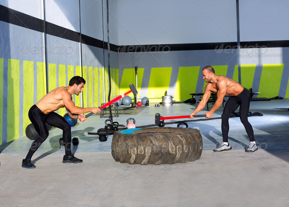 Crossfit sledge hammer men workout - Stock Photo - Images