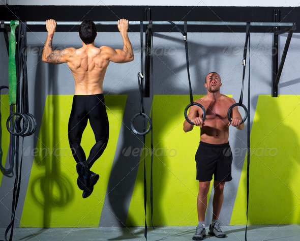 Crossfit dip ring and toes to bar man pull-ups men - Stock Photo - Images