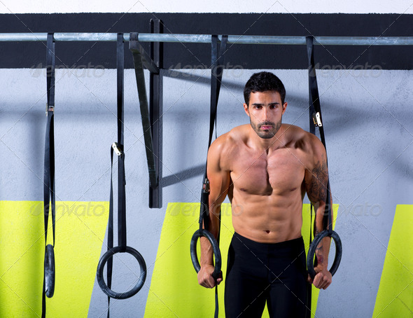 Crossfit dip ring man workout at gym - Stock Photo - Images