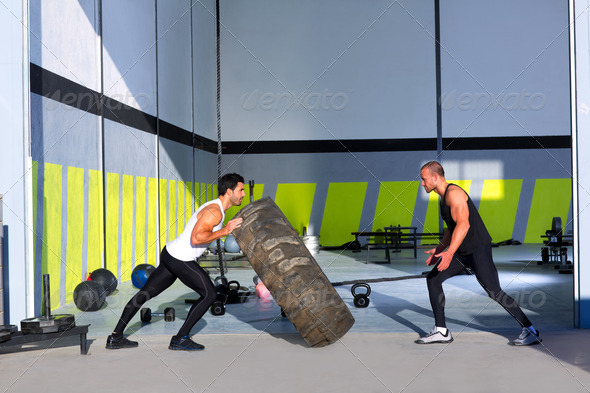Crossfit flip tires men flipping each other - Stock Photo - Images