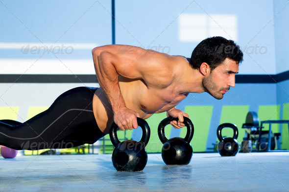 Gym man push-up strength pushup with Kettlebell - Stock Photo - Images
