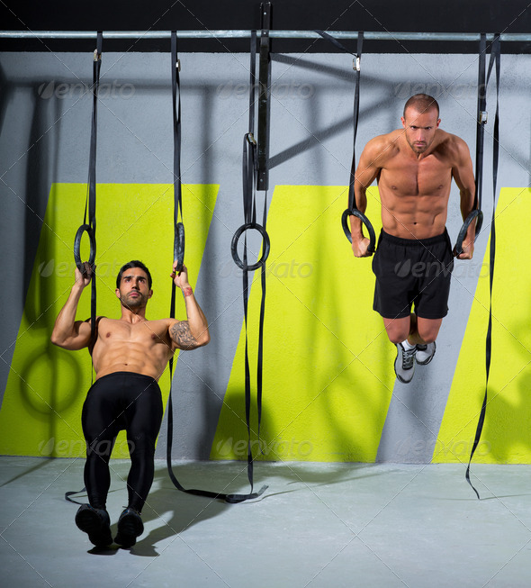 Crossfit dip ring two men workout at gym dipping - Stock Photo - Images