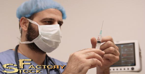 Male Surgeon Checks Medical Syringe  VideoHive Stock Footage  Medical 3720063