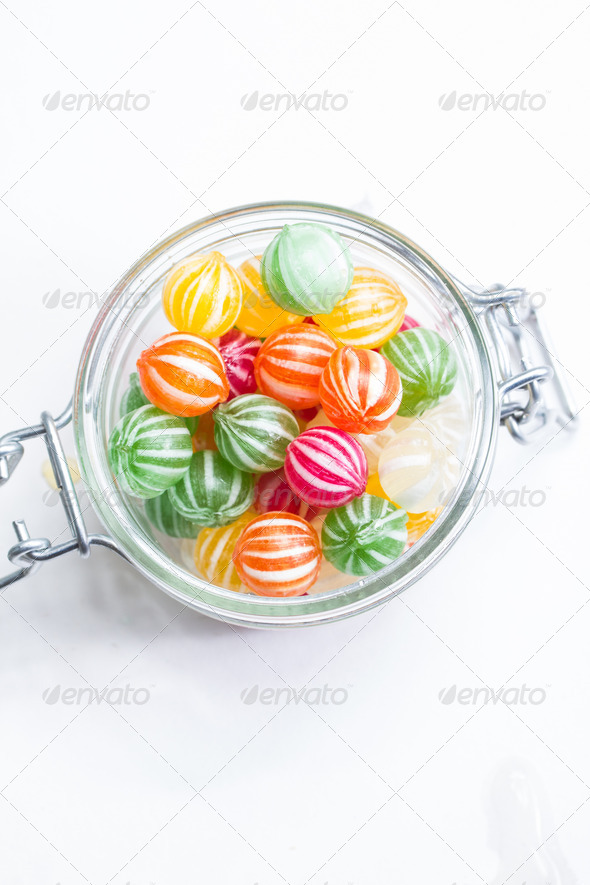 PhotoDune colorful round candies in a glass vessel 3720381