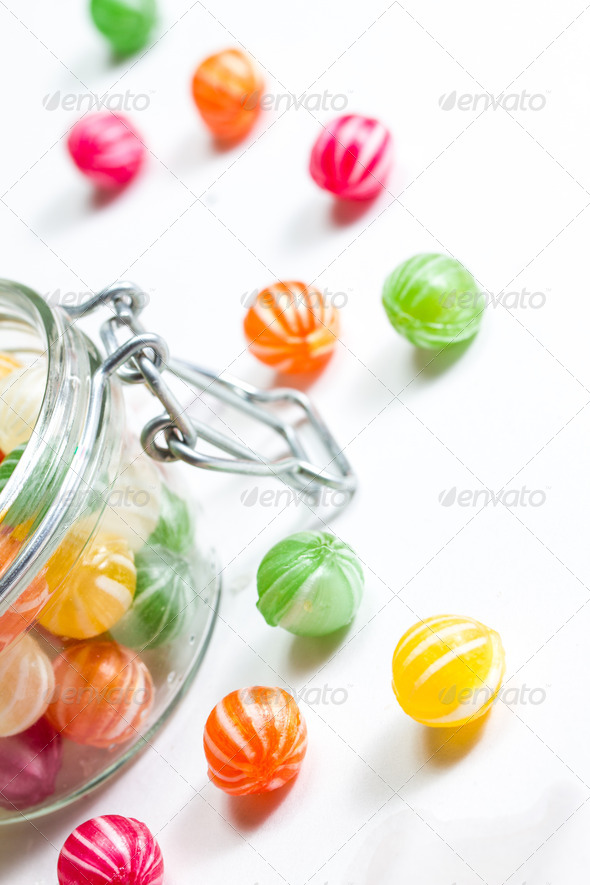 PhotoDune colorful round candies in a glass vessel 3720401