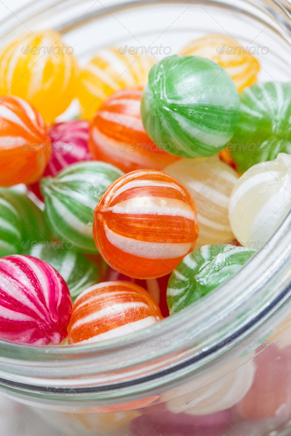 PhotoDune colorful round candies in a glass vessel 3720408