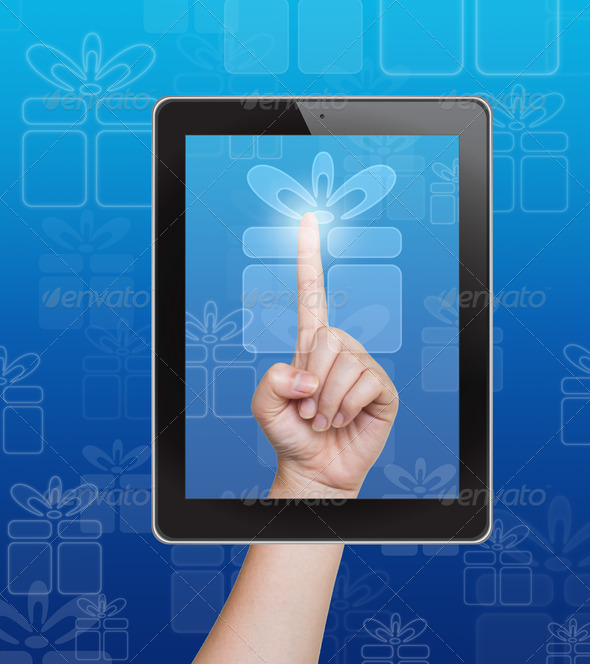 Hand pushing gift box button of tablet on a touch screen - Stock Photo - Images