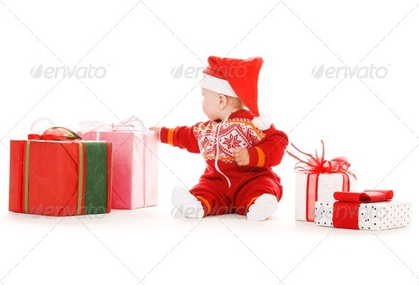 santa helper baby with christmas gifts - Stock Photo - Images