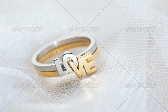 Engagement ring on white veil - Stock Photo - Images