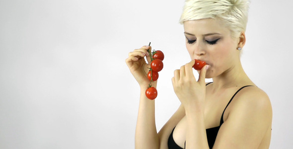 Woman Eating Tomato