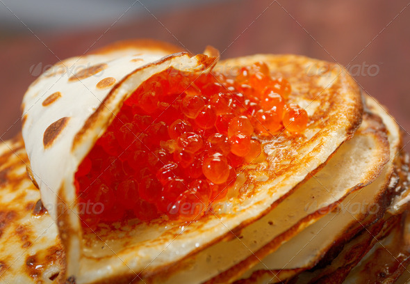 PhotoDune Russian pancakes with red caviar 3743615