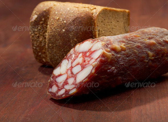 PhotoDune Close-up traditional sausage salami on wooden board 3743626