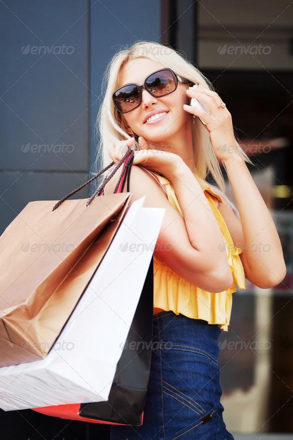 Happy Shopper On The Phone - Stock Photo - Images
