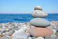 balancing stones on the beach against the sea - PhotoDune Item for Sale
