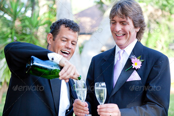 Gay Couple - Champagne Splash - Stock Photo - Images