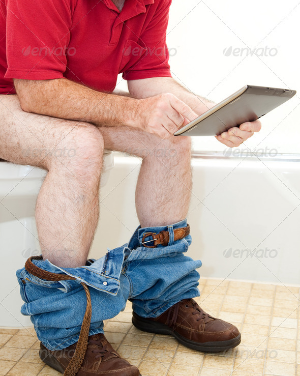 Man On Toilet with Tablet PC - Stock Photo - Images