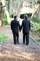 Gay Wedding Couple Walking on Garden Path - PhotoDune Item for Sale